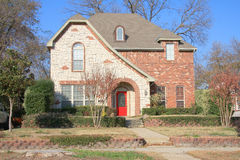 Suburban brick house with garden  Royalty Free Stock Photo