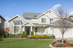 Suburban house. Perfectly manicured suburban house on a beautiful sunny day royalty free stock image