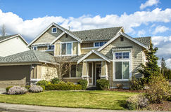 Suburban house. Perfectly manicured suburban house on a beautiful sunny day stock images
