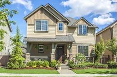 Suburban house. Perfectly manicured suburban house on a beautiful sunny day stock photo