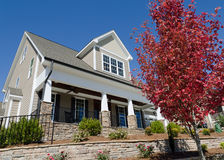 Suburban house with porch. And neat landscaping Royalty Free Stock Image