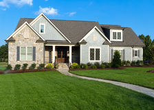 Suburban house. Upscale residential house with large lawn Royalty Free Stock Photography