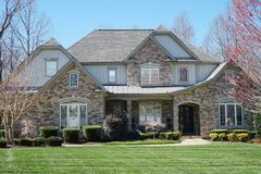 Free Suburban House With Stone Exterior And Green Lawn In An Affluent Neighborhood Royalty Free Stock Photo - 145508755