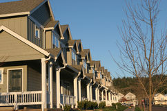 Suburban Houses. Row of new houses in a suburban development, real estate Royalty Free Stock Photo