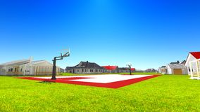 Suburban houses with basketball field Stock Images