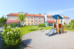 Suburban houses and playground Royalty Free Stock Image