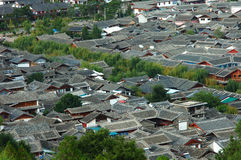 Suburban housing. Grey residential rooftops in a city suburb Stock Photos