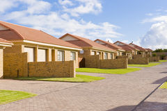 Suburban housing development. A typical suburban housing development showing a row of similar houses in a compound Royalty Free Stock Photos
