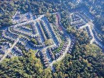 Suburban neighbourhood. Aerial view of upscale suburban neighbourhood surrounded by forest Royalty Free Stock Photography