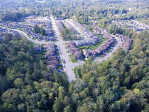 Suburban neighbourhood. Aerial view of upscale suburban neighbourhood surrounded by forest Royalty Free Stock Images