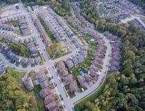 Suburban neighbourhood. Aerial view of upscale suburban neighbourhood surrounded by forest Stock Photo