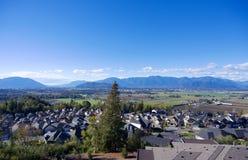 Suburban neighbourhood. Aerial view of upscale suburban neighbourhood surrounded by large mountains Royalty Free Stock Photos