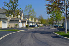 Suburban neighbourhood. A pretty and quiet suburban neighbourhood in the early spring, on a Royalty Free Stock Photography