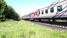 Suburban passenger train coming from city Ulyanovsk in  city Dimitrovgrad. Passing the city. Ulyanovsk, Russia, 06/10/2015, the Editorial video. Summer video stock video footage
