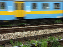 Suburban passenger train in motion. Suburban passanger train passing stock photo