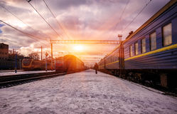 Suburban railway station with different trains Royalty Free Stock Image