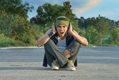 Suburban rapper covering ears Royalty Free Stock Images
