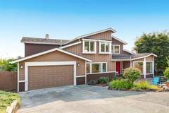 Suburban residential luxury house on Blue sky background Royalty Free Stock Photo