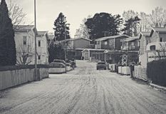 Suburban, residential are during winter. Cars, road and house with some snow. Winter and suburban theme. Suburban, residential are during winter. Cars, road and Stock Images