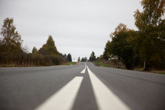 Suburban road in Russia Stock Photography