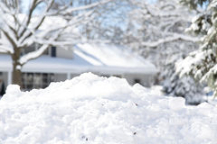 Suburban snow pile. Homeowners running out of space to pile the snow in suburban neighborhoods stock image