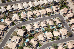 Suburban Southwest. Sunny Southwest neighborhood with swimming pools from above royalty free stock photo