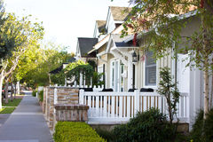 Suburban Street. Homes along a quaint street in a typical American neighborhood Stock Images
