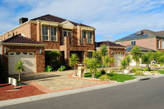 Suburban Street. With new modern houses on a beautiful sunny day royalty free stock images