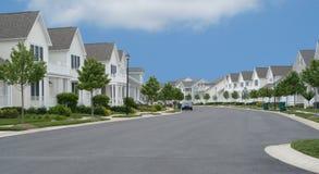 Suburban Street. Pristine houses on a suburban street Royalty Free Stock Photography