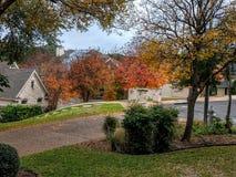Suburban street during fall season Stock Images