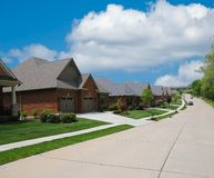 Suburban Street Lined With Brick Homes Stock Photo