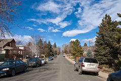Suburban Street Scene. Normal suburban street scene on a peaceful and quiet day with interesting clouds Royalty Free Stock Images