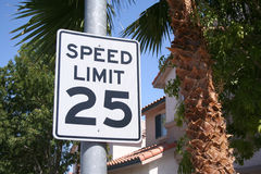 Suburban Street Speed Limit. Speed limit sign in suburban neighborhood, with palm trees and tiled roof house in background. Southern, Western, or Southwestern Stock Photos