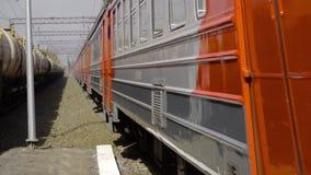 Suburban train arriving. NOVOSIBIRSK REGION, RUSSIA - MAY 8, 2017: Suburban train arriving at the station, suburb of Novosibirsk stock footage