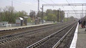 Suburban train arriving. NOVOSIBIRSK REGION, RUSSIA - MAY 8, 2017: Suburban train arriving at the station, suburb of Novosibirsk stock video