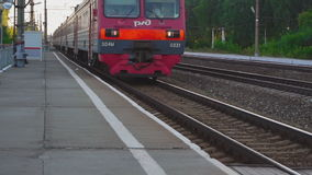 Suburban train arriving. At the station, slow motion stock video