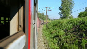 Suburban train. Crosses the forest in the Novosibirsk region stock footage