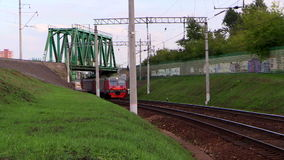 Suburban train leaves from under the bridgeWagons of Suburban train of RZD (Russian railways) leaves from under the bridge. Lyubertsy, Moscow region, Russia. 6 stock video footage