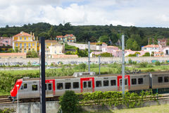 Suburban train of Lisbon passing by S. Domingos de Benfica historic area, Lisbon, Portugal. A suburban train from Lisboa (Lisbon) railway net passing by the Royalty Free Stock Photo