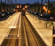 Suburban train at night in Germany. Taken with a long exposure to give a ghostly feeling, a feeling of loneliness stock photos