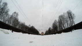 Suburban train passes over the camera. winter shooting.  stock video footage