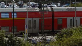 Suburban train passes through the station. DUSSELDORF, GERMANY - JULY 24, 2017: Slow motion of suburban double-decker train passes through the station in stock footage