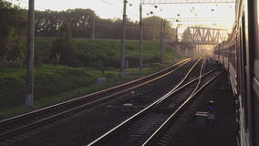Suburban train at sunset stock footage