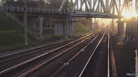 Suburban train at sunset. View from the window of the suburban train, sunset stock video