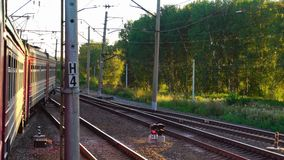 Suburban train at sunset. View from the window of the suburban train, sunset stock video footage
