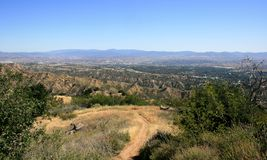 Suburban view from Towsley Canyon. View of suburbs, sky and mountains from a hiking trail Stock Photography
