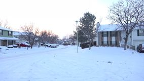 Suburban In Winter Days. A view of suburban neighborhood in snow days at sunset stock footage