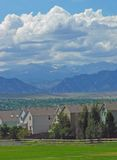Suburbs. This image shows a suburban neighborhood snuggled against the front range of the Rocky Mountains Royalty Free Stock Images
