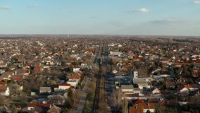 Suburbs from above. Houses and streets aerial view from drone in the suburban parts of Budapest. Train passing by on the Lajosmizse line stock video footage