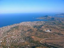 Suburbs of Athens, sea and mountains from aerial view. Suburbs of Athens, Aegean sea and mountains from aerial view. Seascape and landscape of Greece Royalty Free Stock Image